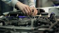 Mechanic customizes the engine in the car, close up Stock Footage