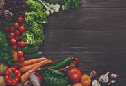Border of fresh vegetables on wooden background with copy space Stock Photos