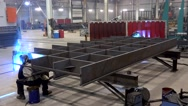 Arc welding of the big metal framework at the Metal structures plant. Stock Footage