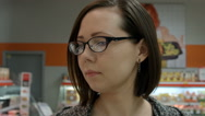 Lady in a supermarket. Closeup Stock Footage
