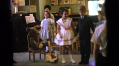 1964: children are seen indoors singing CAMDEN NEW JERSEY Stock Footage