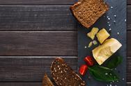 Cheese delikatessen with bread on black stone, parmesan Stock Photos
