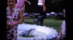 1964: children stand around a fountain in a backyard idly CAMDEN NEW JERSEY Stock Footage