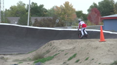 A young man bmx rider riding on a dirt track. Stock Footage