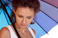 Smiling young brunette woman in white blouse with colour umbrella Stock Photos