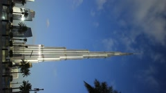 Burj Khalifa at sunny evening, long time lapse, clouds fly over tallest building Stock Footage