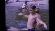 1964: children playing at the beach CAMDEN NEW JERSEY Stock Footage