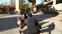 Two young basketball players practicing their ball handling. Stock Footage