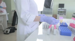 Unrecognizable scientist making laboratory analysis of blood in modern pharmacy Arkistovideo
