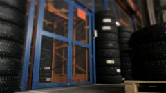 Worker Loads Pallets of Tires In The Elevator Using a Truck Stock Footage