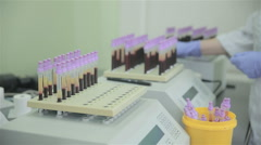 Unrecognizable scientist making laboratory analysis of blood in modern pharmacy Stock Footage