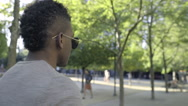 Man Goes For A Walk In City Park On A Beautiful Sunny Day (Slow Motion) Stock Footage