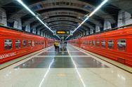 Passengers come to Kievskiy station by Aeroexpress train at night Stock Photos