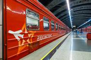 Passengers come to Kievskiy station by Aeroexpress train at night Stock Photos