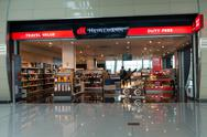 People visit duty free shop in the airport at evening Stock Photos