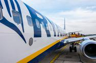 Passengers boarding on the aircraft of low cost airline company Ryanair Stock Photos