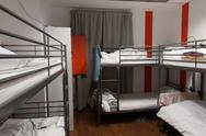 Cheap hostel sleep room Stock Photos