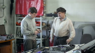 Mechanic doing work in the repair shop Stock Footage