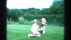 1966: twou couples having fun next to a river, vintage clip Stock Footage