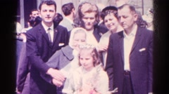 1966: a small girl outside church after her first holy communion with her family Stock Footage