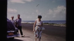 1955: family leaving beach dad drunk being crazy silly MIAMI, FLORIDA Stock Footage