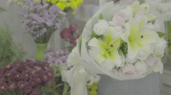 Florist woman giving a beautiful flower bouquet to a customer, ungraded tone Stock Footage