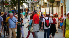 Speeded up tourists on Main Street in Gibraltar, miniature effect Stock Footage