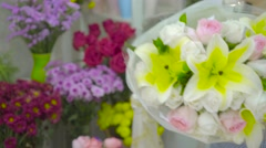 Customer paying money for a flower bouquet with credit card to florist woman Stock Footage