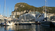 The Rock of Gibraltar over the marina Stock Footage