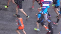 Unrecognizable motion blurred city marathon runners. Competition concept. 4K Stock Footage