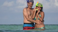 Happy Young Couple Waving On Summer Vacation Swimming In Ocean Stock Footage
