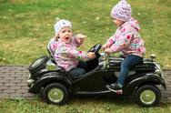 The little baby girl playing at car Stock Photos
