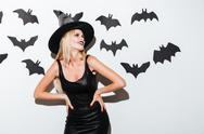 Smiling blonde young woman in witch costume with hat Stock Photos