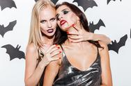 Two sexy young women with vampire halloween makeup Stock Photos