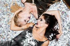 Two seductive young women with gothic vampire makeup lying Stock Photos