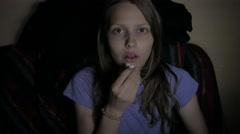 Girl watching horror movie in the cinema. 4K UHD Stock Footage