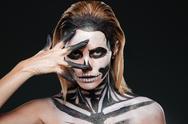 Woman with terrifying halloween makeup Stock Photos