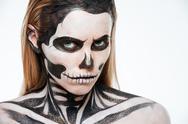 Woman with terrifying skeleton makeup Stock Photos