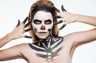 Closeup of woman with gothic terrifying makeup posing Stock Photos