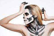 Woman with scared halloween makeup standing and posing Stock Photos