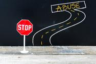 Mini STOP sign on the road to ABUSE Stock Photos