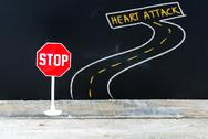 Mini STOP sign on the road to HEART ATTACK Stock Photos