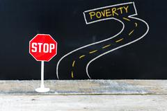 Mini STOP sign on the road to POVERTY Stock Photos