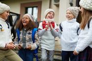 Ecstatic schoolkids spending break between lessons outdoors Stock Photos