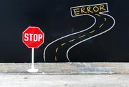 Mini STOP sign on the road to ERROR Stock Photos