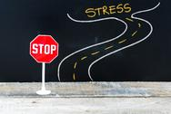 Mini STOP sign on the road to STRESS Stock Photos