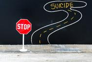 Mini STOP sign on the road to SUICIDE Stock Photos