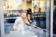 Young couple drinking coffee and relaxing in cafe Stock Photos