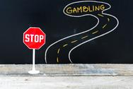 Mini STOP sign on the road to GAMBLING Stock Photos
