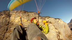 POV of a young man paragliding over a scenic European landscape. Stock Footage